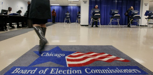In this Jan. 27, 2010, file photo, voters cast their ballots for Illinois' primary at an early voting polling place in Chicago.