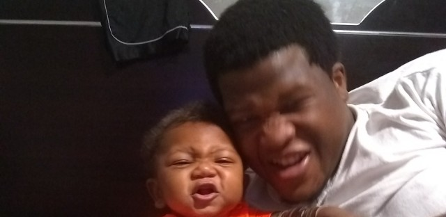 Jemel Roberson and his 9-month-old son.