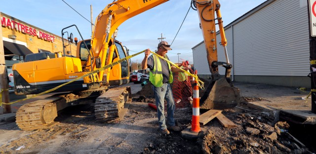 """Workers fix a sewer main below the sidewalk in Mid City New Orleans, Wednesday, Jan. 31, 2018.  The city of New Orleans is perhaps one of the best examples of what President Donald Trump calls the country's """"crumbling infrastructure."""" City officials say New Orleans needs more than $11 billion to update key parts of its infrastructure. The city has about $2 billion in hand, but it's not clear that Trump's bold plan will help make up the gap. New Orleans' mayor says Trump's proposal puts the onus on cities and states to raise taxes and fees to pay for the improvements. (AP Photo/Gerald Herbert)"""