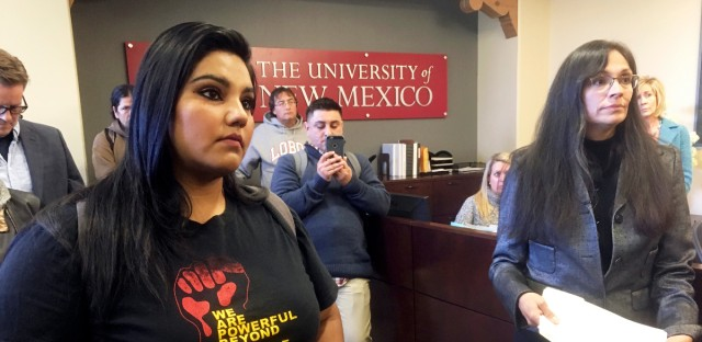 "In this Nov. 18, 2016 file photo, University of New Mexico student LuzHilda Campos, left, and Chicanaa and Chicano studies professor Irene Vasquez, right, present a letter with hundreds of signatures to school president Bob Frank, asking him to declare the campus a ""sanctuary university,"" in Albuquerque, N.M. Universities and colleges in several states are considering labeling themselves ""sanctuary campuses"" amid fears from immigrant students and pressure from activists following the election of Donald Trump."