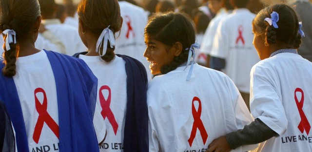 School students interact as they participate in a 'Walk For Life' event, on the eve of World AIDS Day, in New Delhi, India, Sunday, Nov. 30, 2003. The event was an attempt to create awareness on the stigma and discrimination faced by HIV affected people