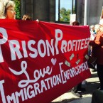 Immigration activists hold a banner while protesting in Portland, Ore., Tuesday, Oct. 15, 2013.