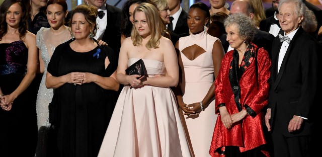The cast and crew of The Handmaid's Tale — including Emmy winners Ann Dowd and Elisabeth Moss, actress Samira Wiley, and author Margaret Atwood — onstage during the 69th Primetime Emmy Awards.