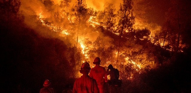 Firefighters monitor a backfire while battling the Ranch Fire, part of the Mendocino Complex Fire, on Tuesday, Aug. 7, 2018, near Ladoga, Calif.