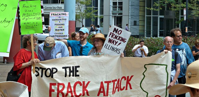 Activists rally against fracking outside the Thompson Center in July 2012.