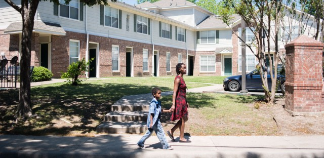 Farryn Giles and her son Isaiah, 6, walk in their east Dallas neighborhood