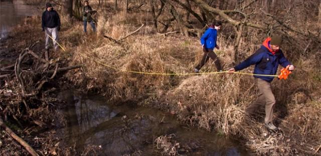 Volunteers measure gullies in Edgebrook Woods.