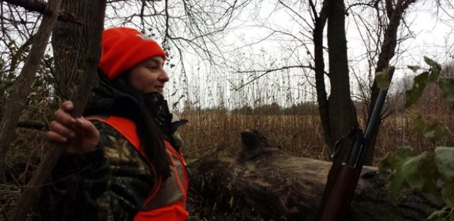 Amy Strahan agreed to become Monica Eng's hunting partner for this year's season in Kankakee County. She sits here in the woods just minutes before a four-point buck approached the two of them.