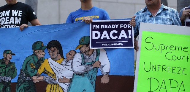Immigration activists rally in Miami ahead of the Supreme Court hearing arguments on President Obama's executive actions on immigration Monday.