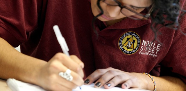 A student at Noble Street College Prep does class works at the school in Chicago in Feb. 2012. Teachers at Chicago's largest network of charter schools are taking the crucial first steps to start a union.