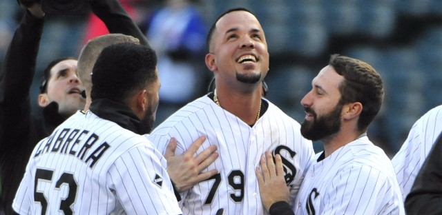 Chicago White Sox first baseman Jose Abreu, center (#79), celebrates his game-winning single with Melky Cabrera (53) and Adam Eaton (#1) against the Texas Rangers within a baseball game, Saturday, April 23, 2016, in Chicago.The White Sox won 4-3 in eleven innings.