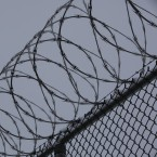 Razor wire lines a walkway at an Illinois prison on Dec. 22, 2009.