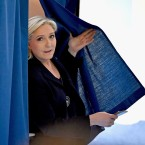 National Front Leader Marine Le Pen, casts her vote for the French elections in a polling station on April 23, 2017 in Henin Beaumont, France.