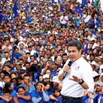 Honduran President Juan Orlando Hernandez participates in a political rally in Sabana Grande, Honduras, Sunday, Nov. 12, 2017. Hernandez is running for re-election in the upcoming Nov. 26 presidential elections.