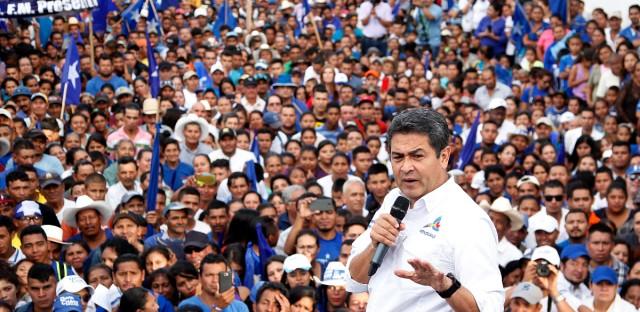 Honduran President Juan Orlando Hernandez participates in a political rally in Sabana Grande, Honduras, Sunday, Nov. 12, 2017. Hernandez is running for re-election in the upcoming Nov. 26 presidential elections.