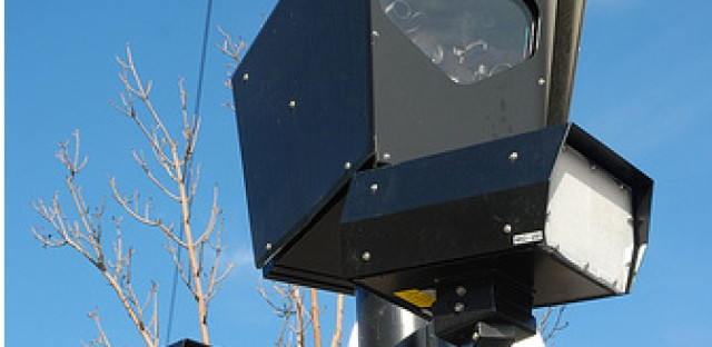 File: Red light camera. The city is hoping to catch speeders with the new cameras at fifty city locations by the end of the year.