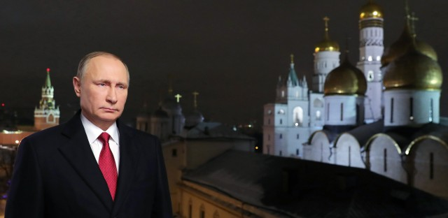 Russian President Vladimir Putin is shown at the Kremlin in Moscow during the recording of his recent New Year's message. Putin's spokesman said Wednesday that the Russian government does not gather compromising material, or kompromat, on political rivals, despite a well-documented history of such behavior.