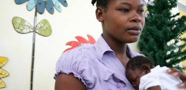 Maudeline Orelien, 22, with her son, Wilguens Pierre, who was born in July with microcephaly.