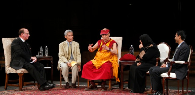 The Dalai Lama is joined by, from left, moderator Dr. James A. Kowalski, translator Geshe Thupten Jinpa, and panelists Sakena Yacoobi and Dr. Eboo Patel as he speaks during a panel discussion at the Cathedral Church of Saint John the Divine Sunday, May 23, 2010 in New York.