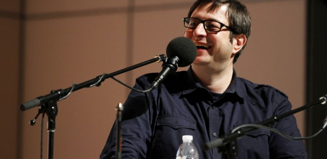 Ask Me Another : Eugene Mirman: Burger On A Sesame Seed Pun Image