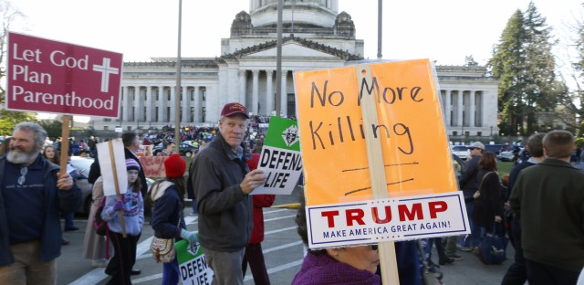 Anti-abortion demonstrators mark the anniversary of Roe v. Wade on Jan. 23, 2017, at the Capitol in Olympia, Wash.