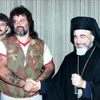 Rino Malcontenti, one of the Italian hostages freed by Iraq, shakes hands with Catholic Archbishop Hilarion Capucci during a press conference in Rome in this 1990 filer.