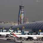 Emirates passenger planes are parked at their gates at the Dubai International Airport in the United Arab Emirates. The U.S. is imposing new restrictions that require most electronic devices, including laptops, tablets and cameras, to be placed in checked baggage on direct flights to the U.S. from eight mostly Muslim countries, including the UAE. Passengers can still carry smartphones.