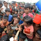 Rohingya Muslim refugees wait to receive food distributed from a Turkish aid agency at Thaingkhali refugee camp in Ukhia, Bangladesh on Saturday.