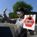 Eliot Monaco displays a friendly gesture so as not to spook pedestrians who may be afraid of mimes.