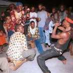 Rastafarians dance to celebrate the birthday of Emperor Haile Selassie 1, July 23, 2002, in Kingston, Jamaica.