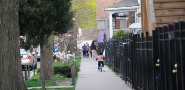 Residents walk in Juvenal's neighborhood. The teen witnessed domestic violence, and now his mom says he needs counseling to deal with the trauma.