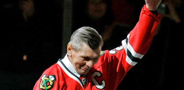 Chicago Blackhawks great Stan Mikita waves to fans as they as he is introduced before an NHL hockey game against the San Jose Sharks in Chicago on March 7, 2008.