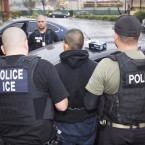 A photo released Tuesday by U.S. Immigration and Customs Enforcement shows people being arrested during an ICE operation.