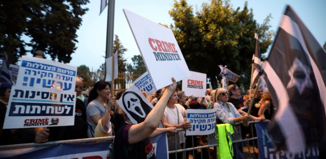 Israelis chant slogans and hold signs as they demonstrate in Jerusalem, Thursday, May 30, 2019. Israel embarked Thursday on an unprecedented snap election campaign - the second this year - after Prime Minister Benjamin Netanyahu failed to form a governing coalition and instead dissolved parliament.