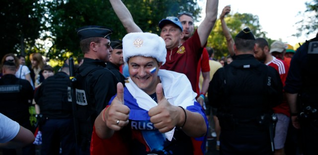 Russians fans walk towards the Stadium municipal ahead of the Euro 2016 Group B soccer match between Russia and Wales.