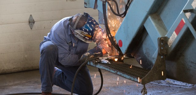 City blacksmith Luke Gawel welds a step back on to a garbage truck. This is one of the smaller jobs a city blacksmith can do, he says.