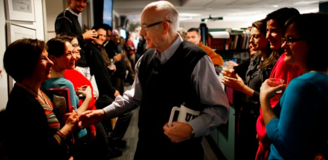 NPR employees line the hallway of the Morning Edition newsroom to cheer for Kasell. He was feted with speeches, champagne and cake following his final 11 a.m. newscast.