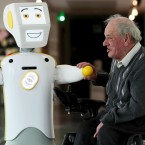 Ireland's first socially assistive robot with artificial intelligence (AI) features, 'Stevie II', from robotics engineers at Trinity College Dublin, is unveiled during a special demonstration at the Science Gallery in Dublin, with Brendan Crean, who helped trial the robot through the charity ALONE, look on, in Dublin, Ireland, Wednesday May 15, 2019.