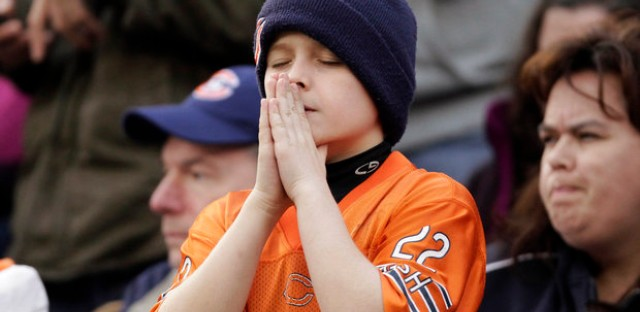 A Bears fan's prayer is not answered in the OT loss.