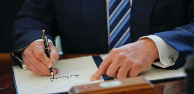 President Donald Trump signs