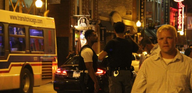 Police officer patrol a busy part of Clark Street on a Saturday night. The Wrigleyville neighborhood is part of the CPD's 19th district and the area near the ball park is defined as beat 1924.