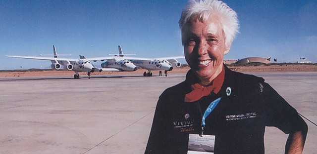 Wally Funk poses in front of the Virgin Galactic spacecraft in 2015 in the Mojave Desert. Funk has a ticket and hopes to be on its first flight into space.