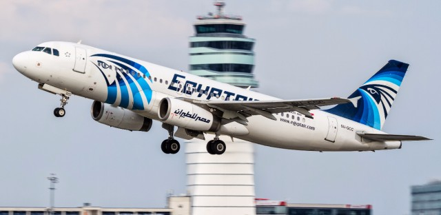 """This August 21, 2015 photo shows an EgyptAir Airbus A320 with the registration SU-GCC taking off from Vienna International Airport, Austria. Egyptian aviation officials said on Thursday May 19, 2016 that an EgyptAir plane with the registration SU-GCC, traveling from Paris to Cairo with 66 passengers and crew on board has crashed off the Greek island of Karpathos. Meanwhile, Egypt's chief prosecutor Nabil Sadek says he has ordered an """"urgent investigation"""" into crash. Sadek instructed the National Security Prosecutor to open an """"extensive investigation"""" in the incident."""