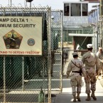 U.S. military guards walk within Camp Delta military-run prison, at the Guantanamo Bay U.S. Naval Base, Cuba. Fears that Donald Trump will make good on his pledge to bring more prisoners to the U.S. base in Cuba have human rights groups making a final push for President Obama to close the detention center before he leaves office. But the odds are against that with 60 prisoners left, only a third currently cleared for release.
