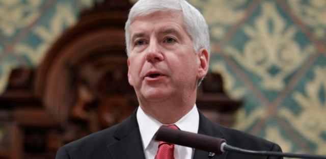 Michigan Gov. Rick Snyder delivers his State of the State address to a joint session of the House and Senate, Tuesday, Jan. 19, 2016, at the state Capitol in Lansing, Michigan.