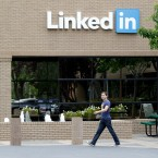 A man walks past the LinkedIn headquarters in Mountain View, Calif.