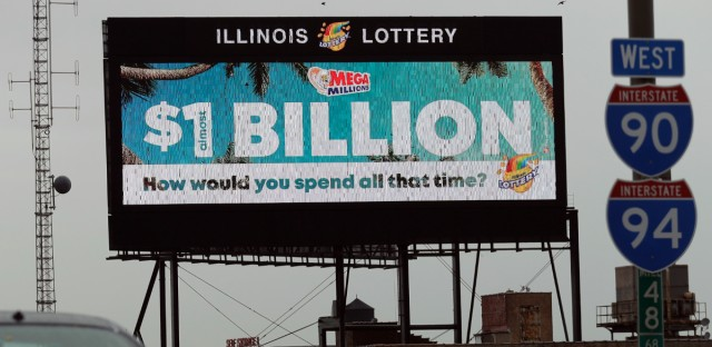 A digital billboard along I-90/94 highway in Chicago, displays the estimated Mega Millions jackpot, Friday, Oct. 19, 2018. Friday's jackpot has soared to $1 billion, the second-largest prize in U. S. lottery history. (AP Photo/Nam Y. Huh)