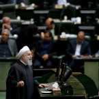 "Iranian President Hassan Rouhani speaks during parliament's open session on confidence vote for four new ministers, in Tehran, Iran, Saturday, Oct. 27, 2018. Rouhani urged Parliament to approve four new ministers and help his government ""resist"" and ""fight"" the U.S. as it reinstates sanctions against the Islamic Republic."