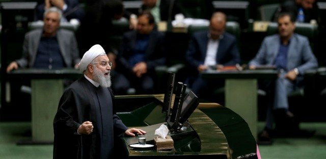 """Iranian President Hassan Rouhani speaks during parliament's open session on confidence vote for four new ministers, in Tehran, Iran, Saturday, Oct. 27, 2018. Rouhani urged Parliament to approve four new ministers and help his government """"resist"""" and """"fight"""" the U.S. as it reinstates sanctions against the Islamic Republic."""