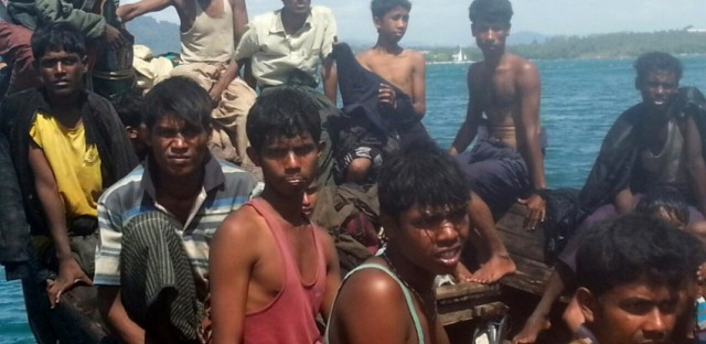 Rohingya refugees sit in a boat as they are intercepted by Thai authorities in January of 2013.